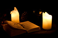 Open book seen by candlelight
